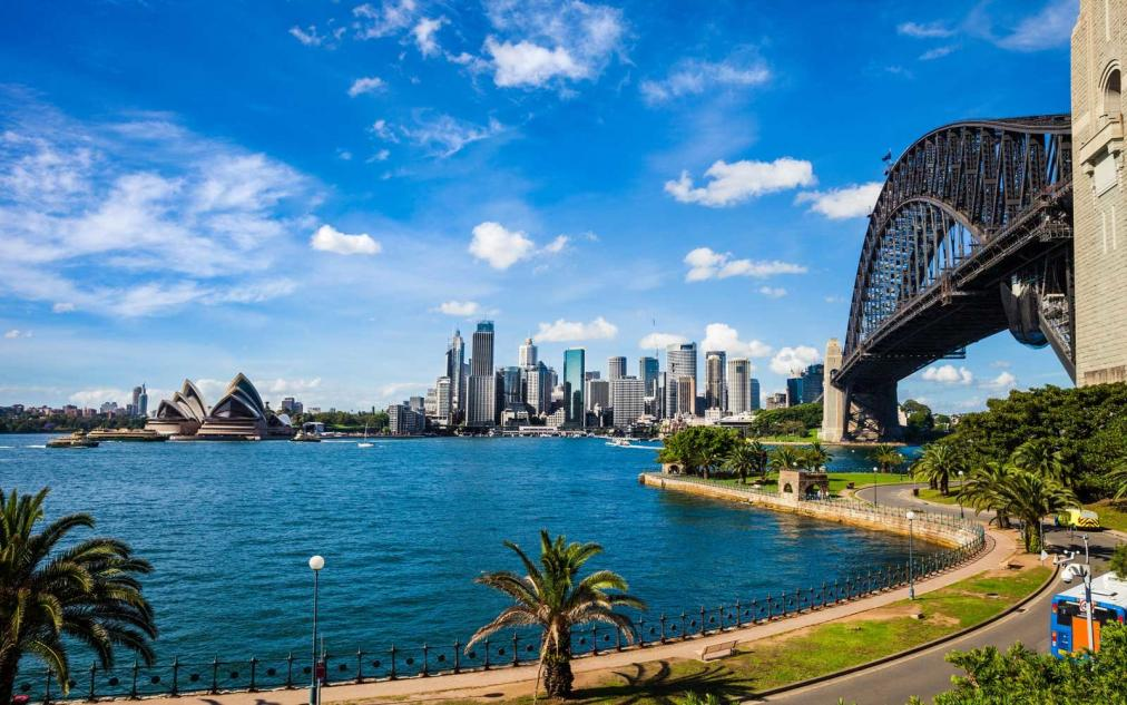 Photo of Sydney Opera House and the city skyline during the day