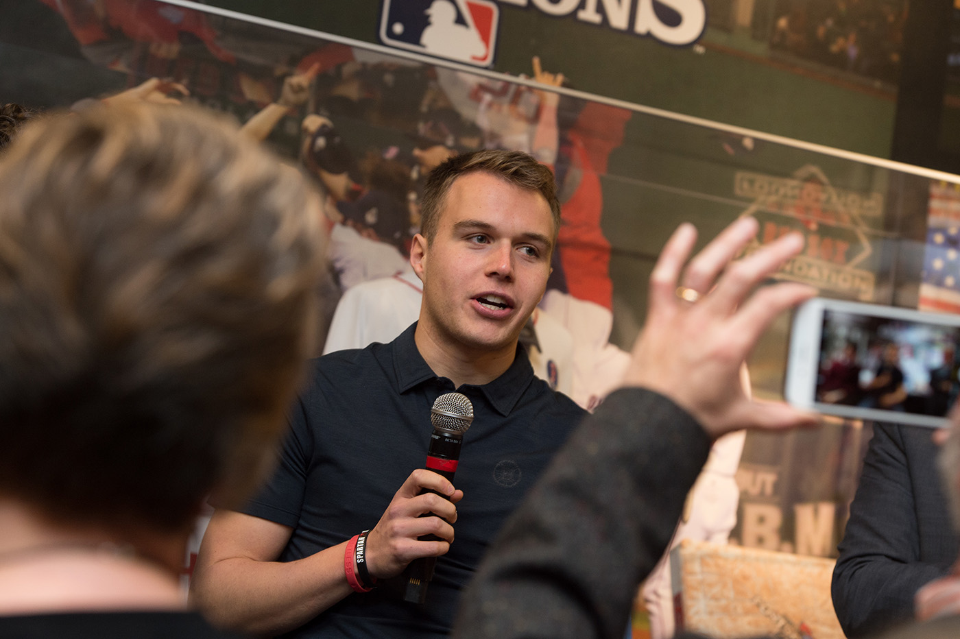 student speaks at sports communication program launch event at fenway park